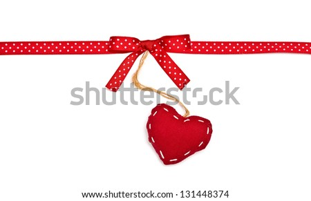 Red ribbon in white peas, a bow and heart. Isolated on a white background - stock photo