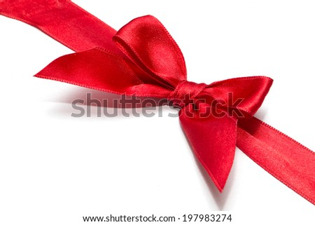 red ribbon with bow with tails isolated on white background - stock photo