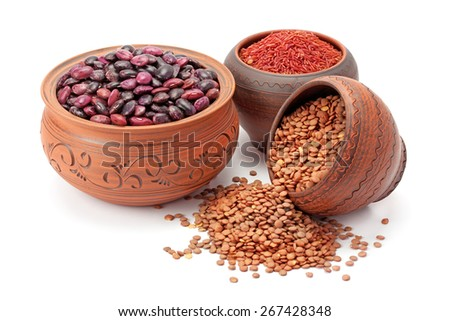 red rice and lentils in clay pots isolated on white background - stock photo