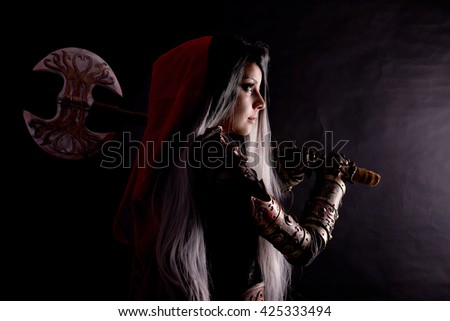 red riding hood isolated on a dark background - stock photo