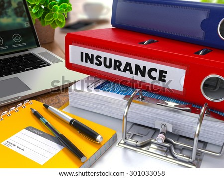 Red Ring Binder with Inscription Insurance on Background of Working Table with Office Supplies, Laptop, Reports. Toned Illustration. Business Concept on Blurred Background. - stock photo