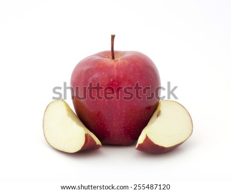 Red Ripe Apple with slices on white background - stock photo
