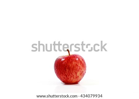 Red ripe fresh apple on white background.