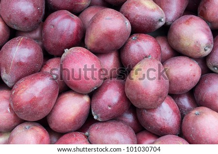 Red ripe pears on display at the farmers market - stock photo