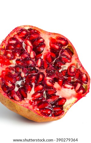 Red ripe pomegranate close up image on white background