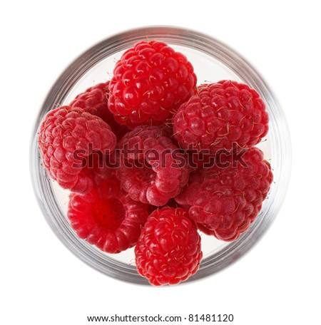 Red ripe raspberry fruit in transparent glass, isolated on white macro - stock photo