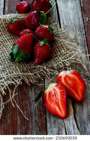Red ripe strawberries on Wooden Background. Summer or Spring Organic Berry over Wood. Agriculture, Gardening, Harvest Concept.  - stock photo