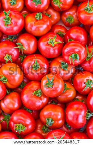 Red ripe tomatoes as a background with copy space