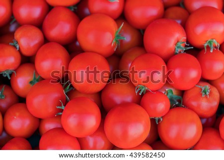 Red ripe tomatoes background - stock photo
