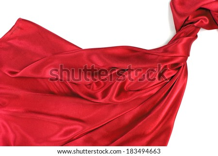 Red rippling silk fabric on white background