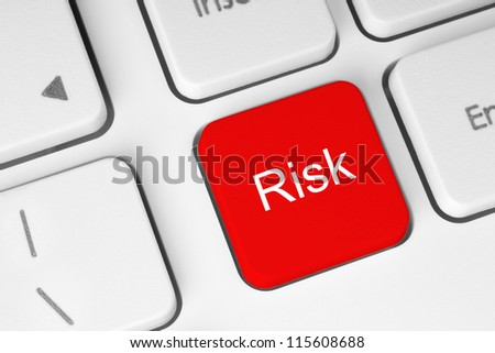 Red risk button on the keyboard - stock photo