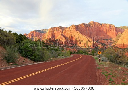 Red road in Zion National Park, Utah, USA. - stock photo