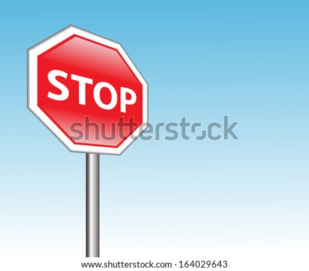 "red road sign ""stop"" on a background of blue sky"