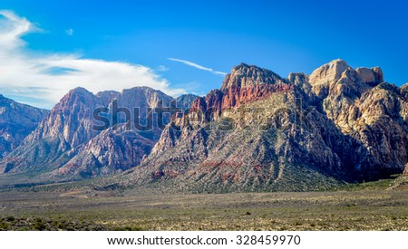 Red Rock  Canyon in Las Vegas, Nevada with blue sky and white clouds - stock photo