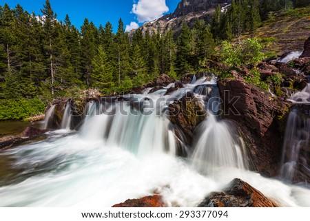 Red Rock Falls at Many Glacier, Glacier National Park - stock photo