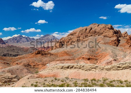 Red rocks amid blue sky in Valley of Fire State Park - stock photo