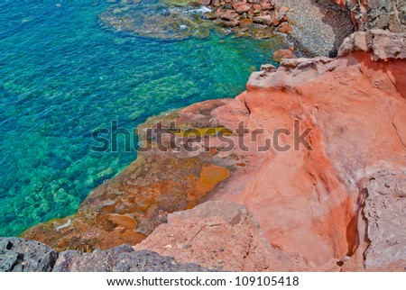 Red rocks by the ocean, viewed from above - stock photo
