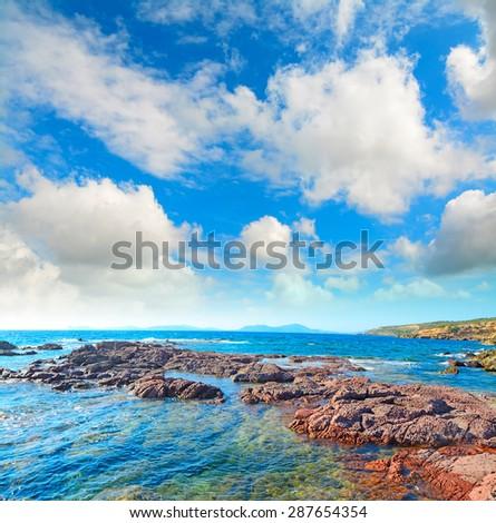 red rocks by the sea in Sardinia, Italy - stock photo