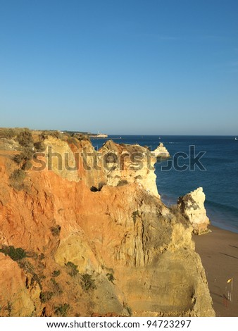 Red rocks in the afternoon sun on the Algarve coast. Portugal