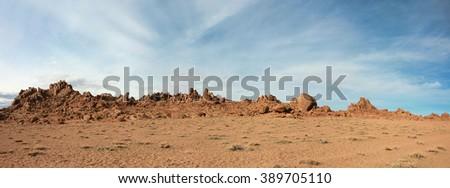 Red rocks in the barren sands of the Gobi Desert - stock photo