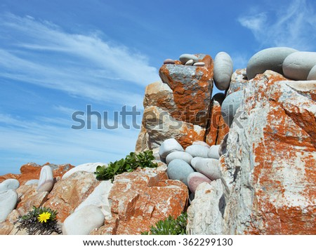 Red rocks lying on the shore. With a beautiful sky. Africa, landscape - stock photo
