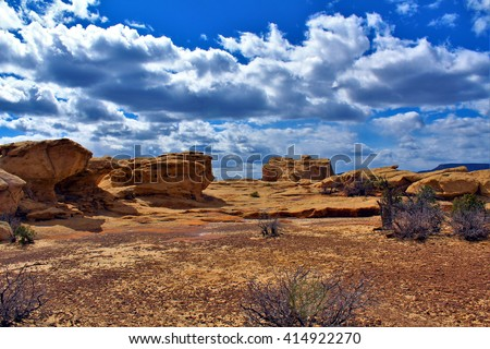 Red Rocks on Sandstone Bluffs of El Malpais National Monument, New Mexico. April 26, 2016. - stock photo