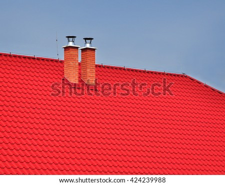 Red roof covering chimney - stock photo