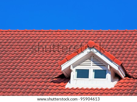 Red Roof on blue sky - stock photo