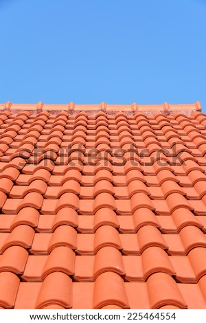 red roof texture tile and blue sky in background  - stock photo