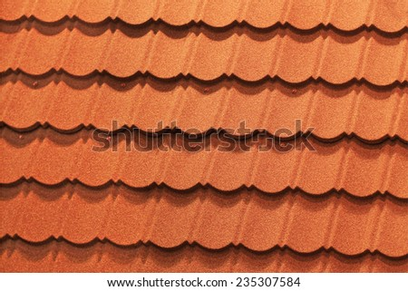 Red roof tiles on the roof of a modern home - stock photo