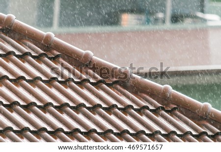 Red roof with blurred focus,rooftop with raining.