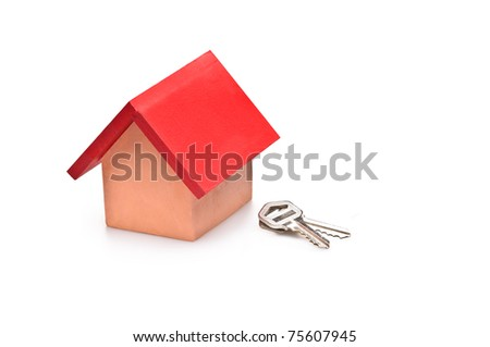 red roofed house over white with house keys