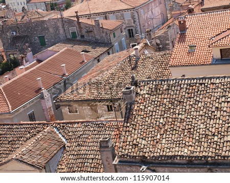 Red roofs of an old city - stock photo