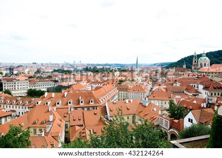 Red roofs of the city Prague shot from the high point - stock photo