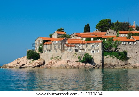 Red roofs. Sveti Stefan,  Montenegro - stock photo