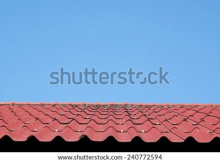 red rooftop roof with blue sky  - stock photo