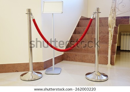 Red rope barriers  - stock photo