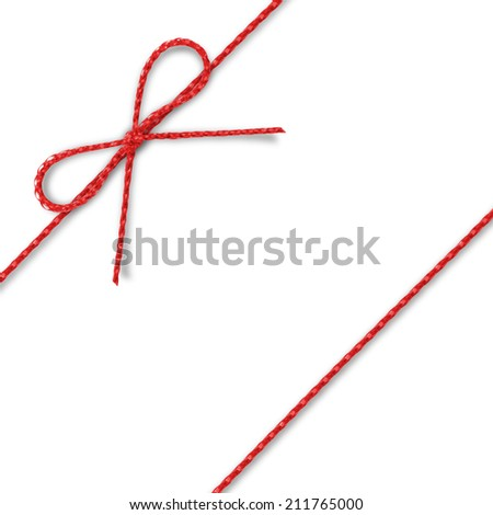 Red rope bow on a white background. - stock photo