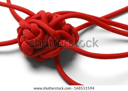 Red Rope in A Tangled Mess Isolated on White Background. - stock photo