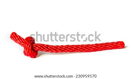 Red rope with a knot isolated on white Background . - stock photo
