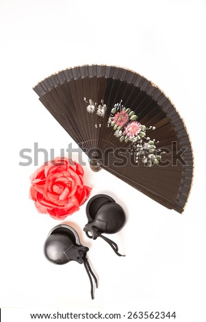 Red rose, a fan, and castanets on a white background - stock photo