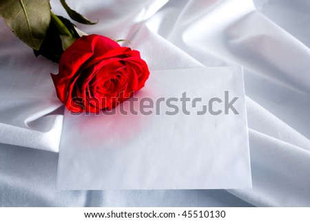 Red rose an letter on silk