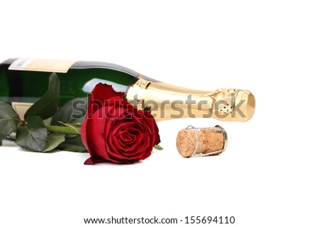 Red rose and a bottle of champagne. Isolated on white background.