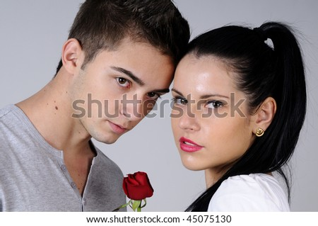red rose and beautiful couple - stock photo