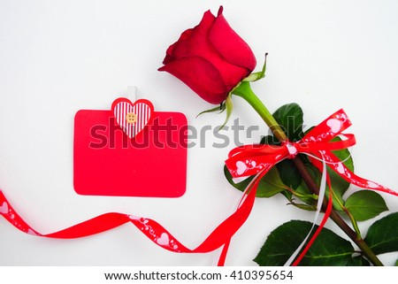 Red rose and blank gift card for text - stock photo