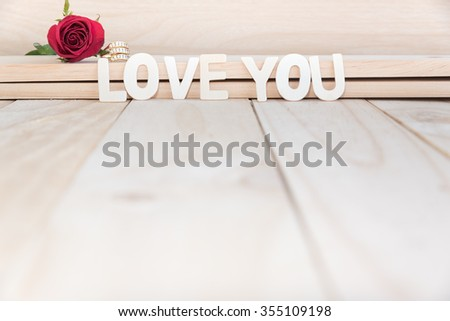red rose and diamond ring with copy space, love concept for valentines day, wedding and anniversary - stock photo
