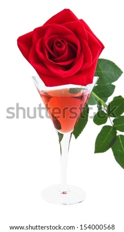 red rose and liquor in a celebratory glass - stock photo
