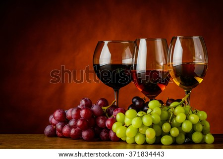Red, rose and white wine in wine-glasses with copy-space