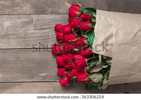 Red rose bouquet closeup on old wood background  - stock photo