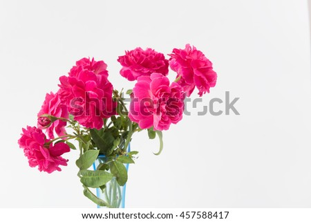Red rose bouquet in blue vase isolated on white background